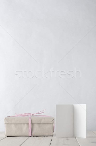 Wrapped Gift Box on Table with Icy Pink Raffia and Greeting Card Stock photo © frannyanne