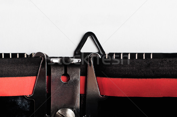 Retro Typewriter with Blank Paper Close Up Stock photo © frannyanne