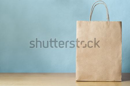Blank Brown Carrier Bag with Handles on Light Wood Veneer Table  Stock photo © frannyanne