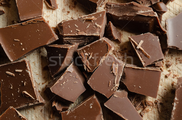 Chocolate Pieces Broken and Scattered on Wooden Board Stock photo © frannyanne