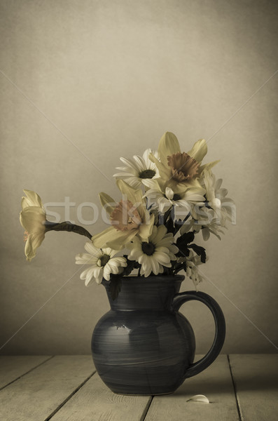 Old Fading Flowers in Blue Jug Stock photo © frannyanne