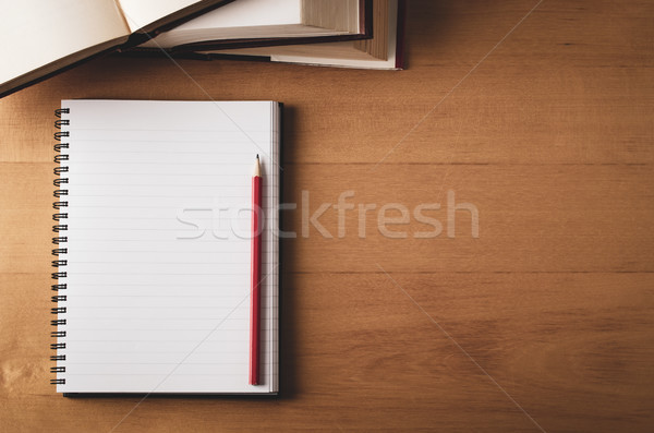 Overhead of Desk with Opened Notebook, Textbooks and Pencil Stock photo © frannyanne