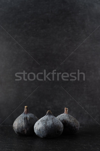 Three Figs Grouped on Black Stock photo © frannyanne