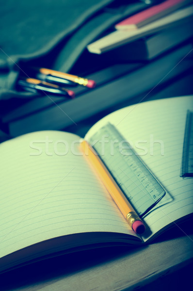 School Exercise Book Opened on Desk with Satchel in Background Stock photo © frannyanne