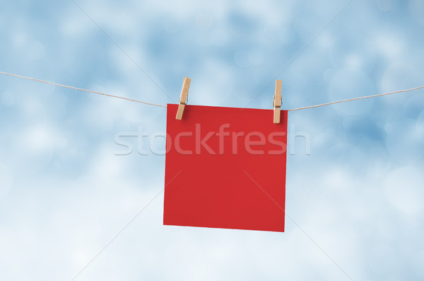 Red Christmas Note Paper Pegged to Clothes Line against Snowy Sk Stock photo © frannyanne