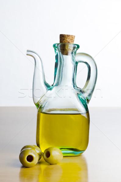 Jug of Olive Oil with Olives Stock photo © frannyanne