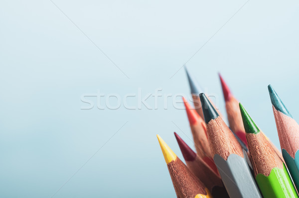 Art Pencil Colours Grouped Together on Blue Background Stock photo © frannyanne