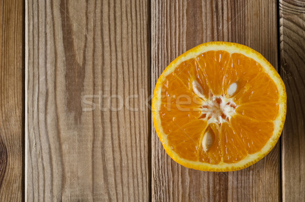 Cut Orange From Above on Wood Stock photo © frannyanne