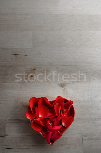 Aerial View of Rose Petals in Heart Shaped Bowl on Wood Stock photo © frannyanne
