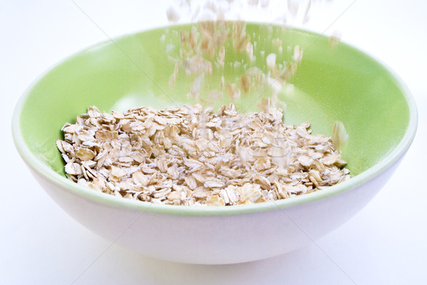 Stock photo: Porridge Oats Pouring into Bowl