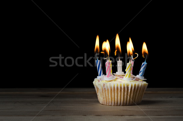 Stock photo: Birthday Cupcake with Lit Candles on Black