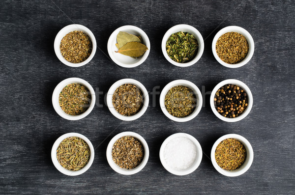 Overhead of Dried Herbs and Condiments in Bowls Stock photo © frannyanne