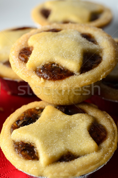 Stock photo: Christmas Mince Pies Piled on Plate with Red Napkin