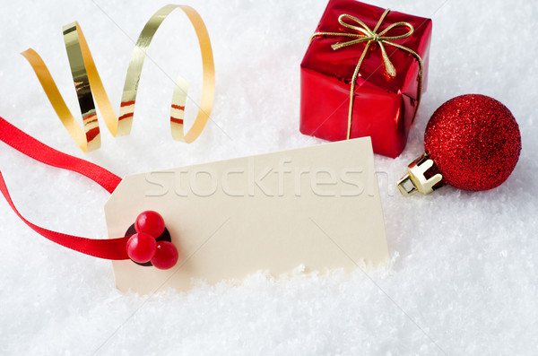 Christmas Tag in Snow with Ornaments Stock photo © frannyanne