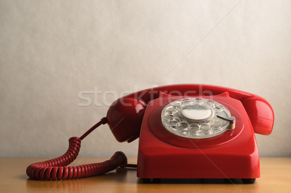 Retro Red Telephone on Light Wood Veneer Table Stock photo © frannyanne