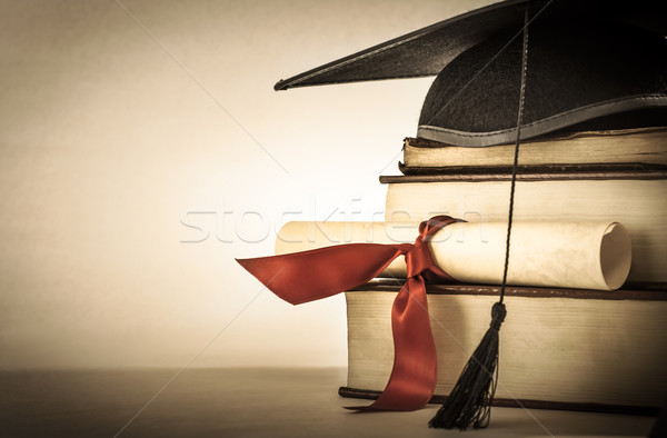 Stock photo: Graduation Scroll and Book Stack