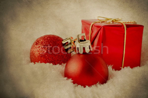 Red Christmas Decorations in Snow - Vintage Grunge Stock photo © frannyanne