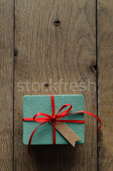 Stock photo: Turquoise Gift Box with Red Ribbon and Vintage Style Blank Tag