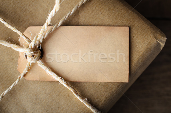 Close Up of Aged Blank Label on String Tied Parcel Stock photo © frannyanne