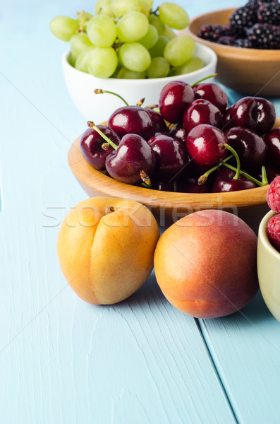 Selection of Fruit Bowls on Blue Wood Plank Table Stock photo © frannyanne