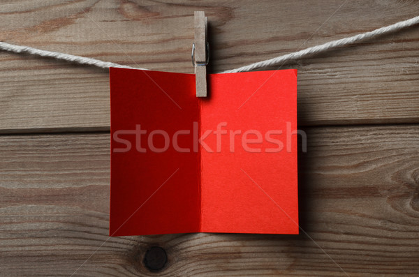 Red Greetings Card Pegged to String on Wood Background Stock photo © frannyanne
