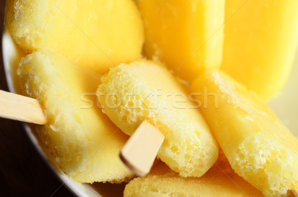 Yellow Pineapple Ice Lollies Grouped in White Bowl Overhead Clos Stock photo © frannyanne