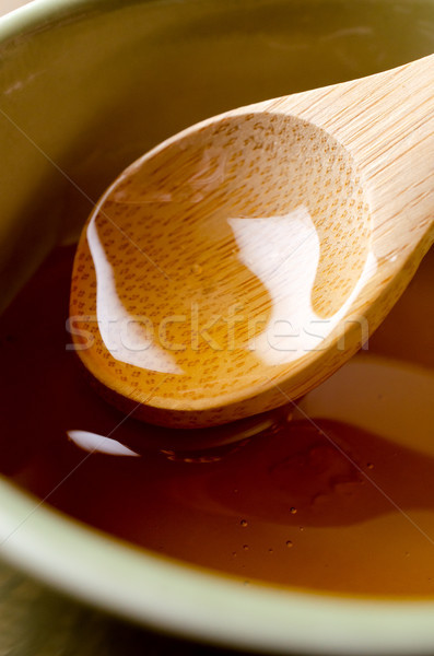 Wooden Spoon Lifting Honey Stock photo © frannyanne
