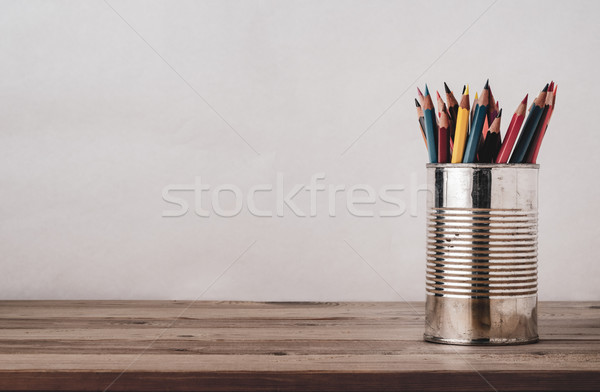 Coloured Drawing Pencils in Metal Tin on Wood Plank Desk Stock photo © frannyanne