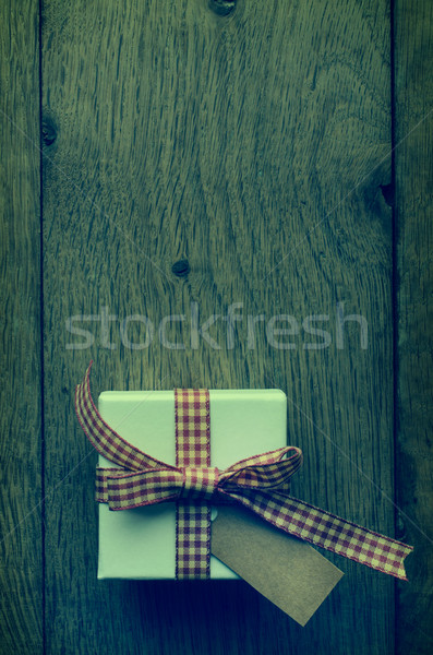 Stock photo: Cross Processed Gift Box on Wood From Above