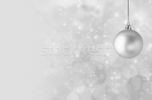 Silver Christmas Bauble on Starry Bokeh Background Stock photo © frannyanne