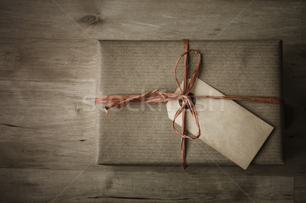 Gift Box with Simple Wrapping and Grungy Parcel Tag Stock photo © frannyanne