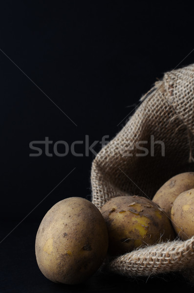 Potatoes Spilling from Hessian Sack Stock photo © frannyanne