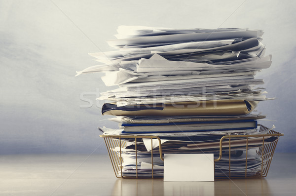 Filing Tray Piled High with Documents in Drab Hues Stock photo © frannyanne