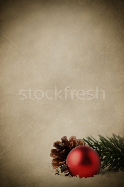 Christmas Background with Red Bauble and Foliage on Snow - Vinta Stock photo © frannyanne