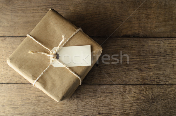 Brown Paper Parcel Tied with String and Blank Label Stock photo © frannyanne