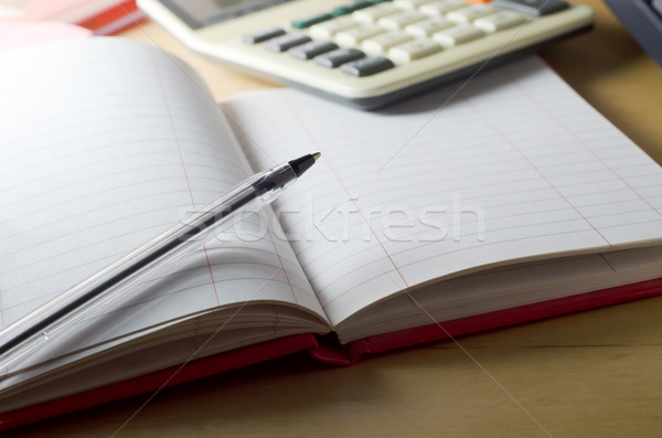 Blank Cash Book and Calculator Stock photo © frannyanne