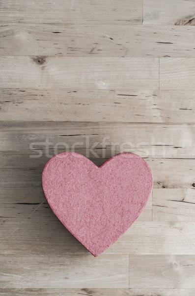 Pink Heart Shaped Box on Wood Plank Table from Above Stock photo © frannyanne