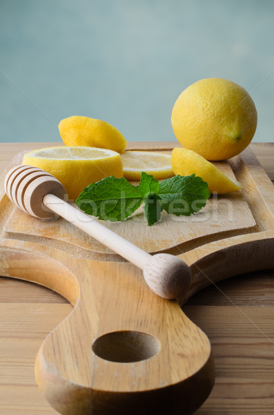 Sliced Lemons and Peppermint Leaves on Wooden Chopping Board Stock photo © frannyanne