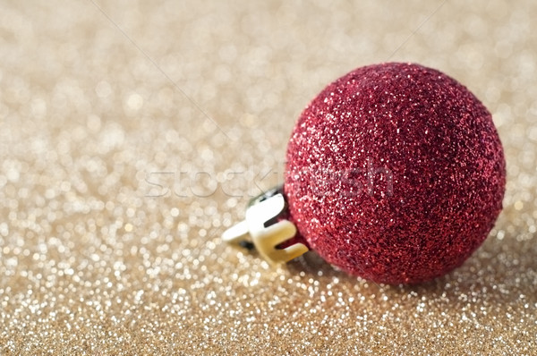 Red Sparkly Bauble on Gold Glitter Stock photo © frannyanne