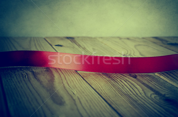 Vintage Style Red Ribbon on Wood - Cross Processed Stock photo © frannyanne