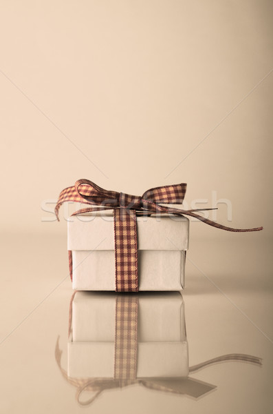 Retrol White Christmas Gift Box with Gingham Ribbon Stock photo © frannyanne