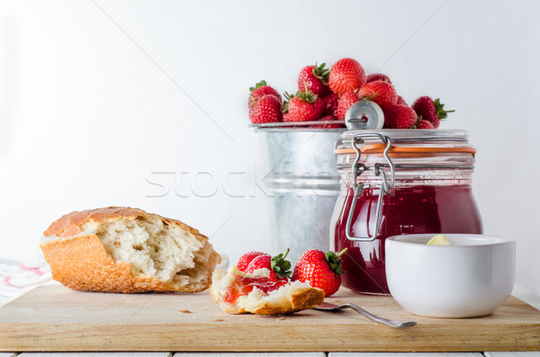 Fresh Strawberry Jam Snack Scene with Bucket of Strawberries Stock photo © frannyanne