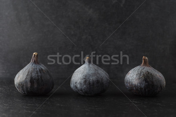 Row of Figs on Black Stock photo © frannyanne