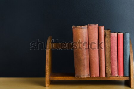 Bookshelf on Desk with Chalkboard Background Stock photo © frannyanne