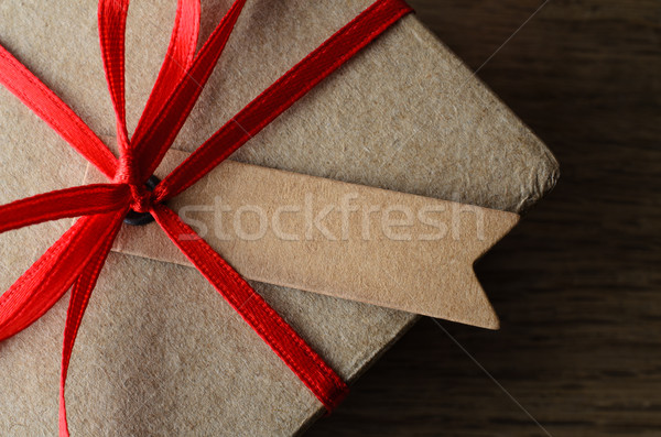Close Up of Blank Tag on Gift Box with Red Ribbon Stock photo © frannyanne