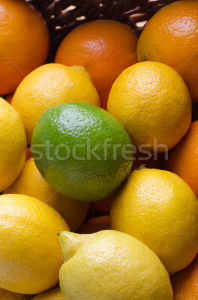 Citrus Fruit Basket Close Up Topped with Lime Stock photo © frannyanne