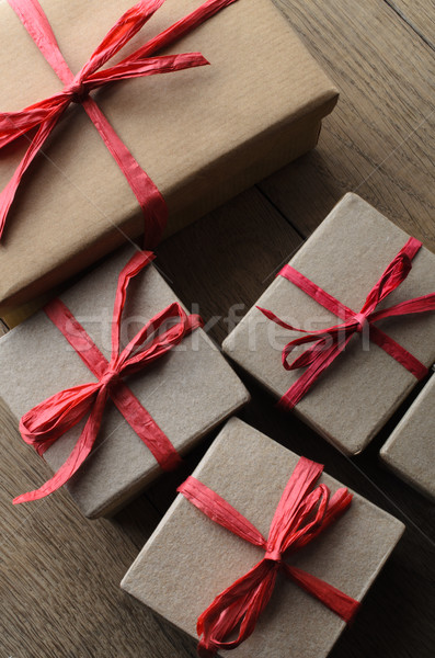 Overhead of Gift Boxes Tied with Red Ribbon on Wood Stock photo © frannyanne