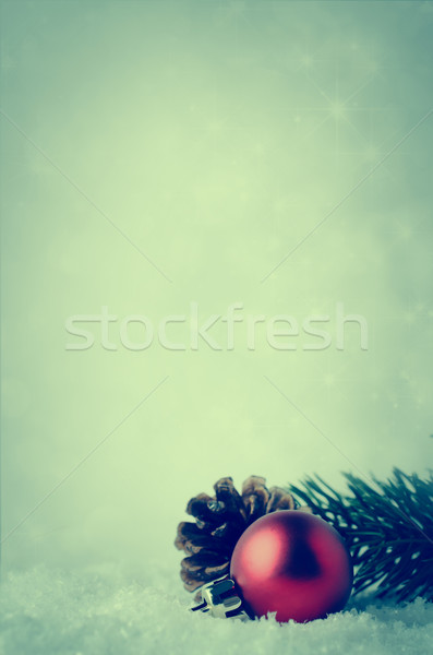 Christmas Background with Red Bauble and Foliage on Snow Stock photo © frannyanne