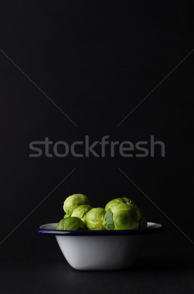 Brussel Sprouts Piled High in Enamel Baking Tin on Black Backgro Stock photo © frannyanne