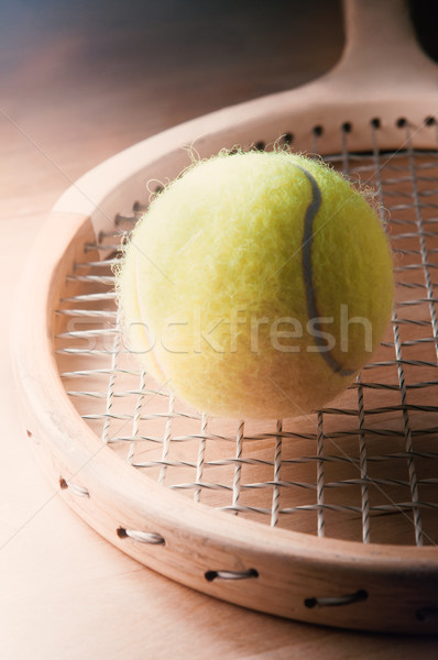 Stock photo: Retro Wooden Tennis Racquet with Ball on Table